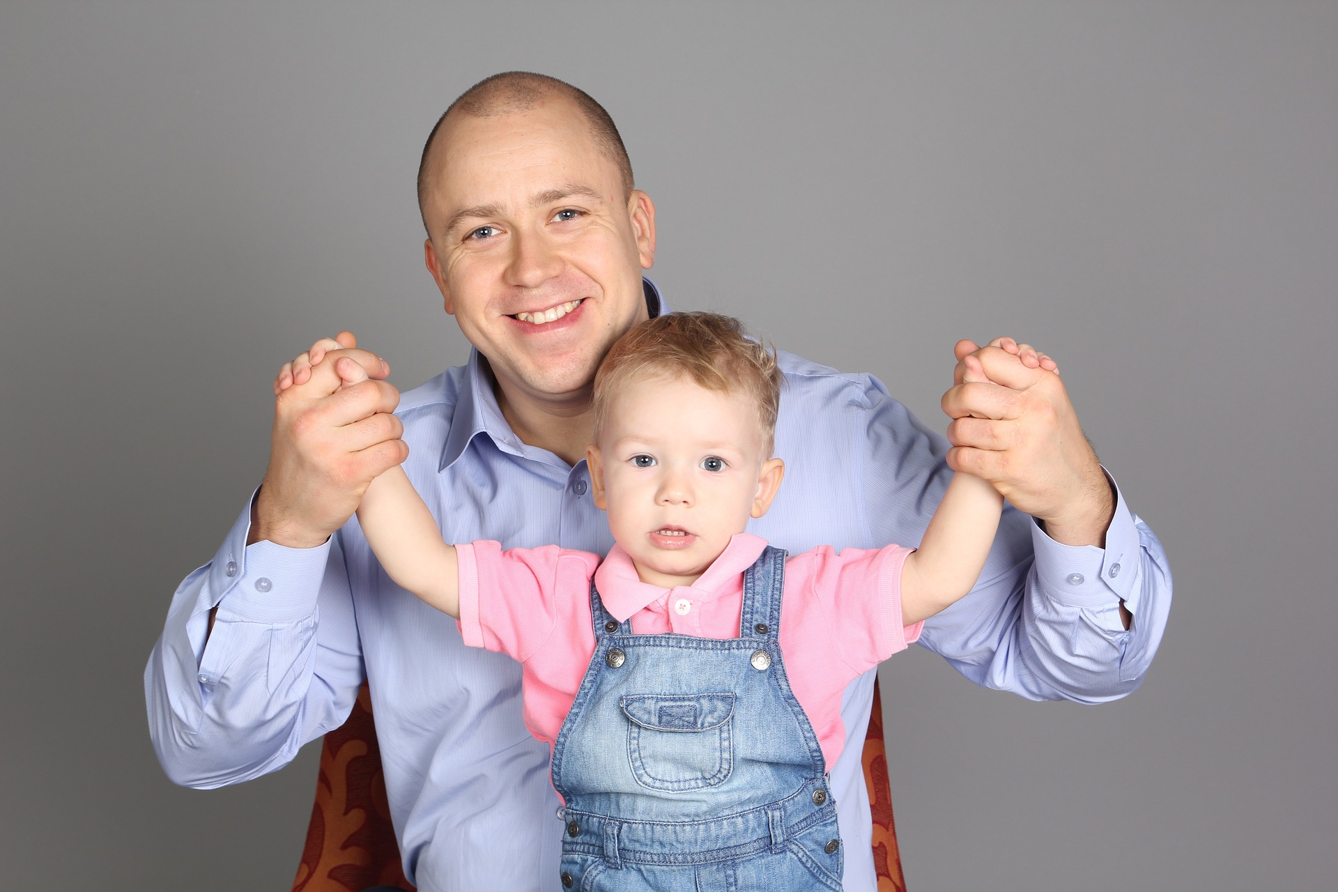 Father and Son happy after their experiences at Treforys Tiny Tots Creche in Swansea